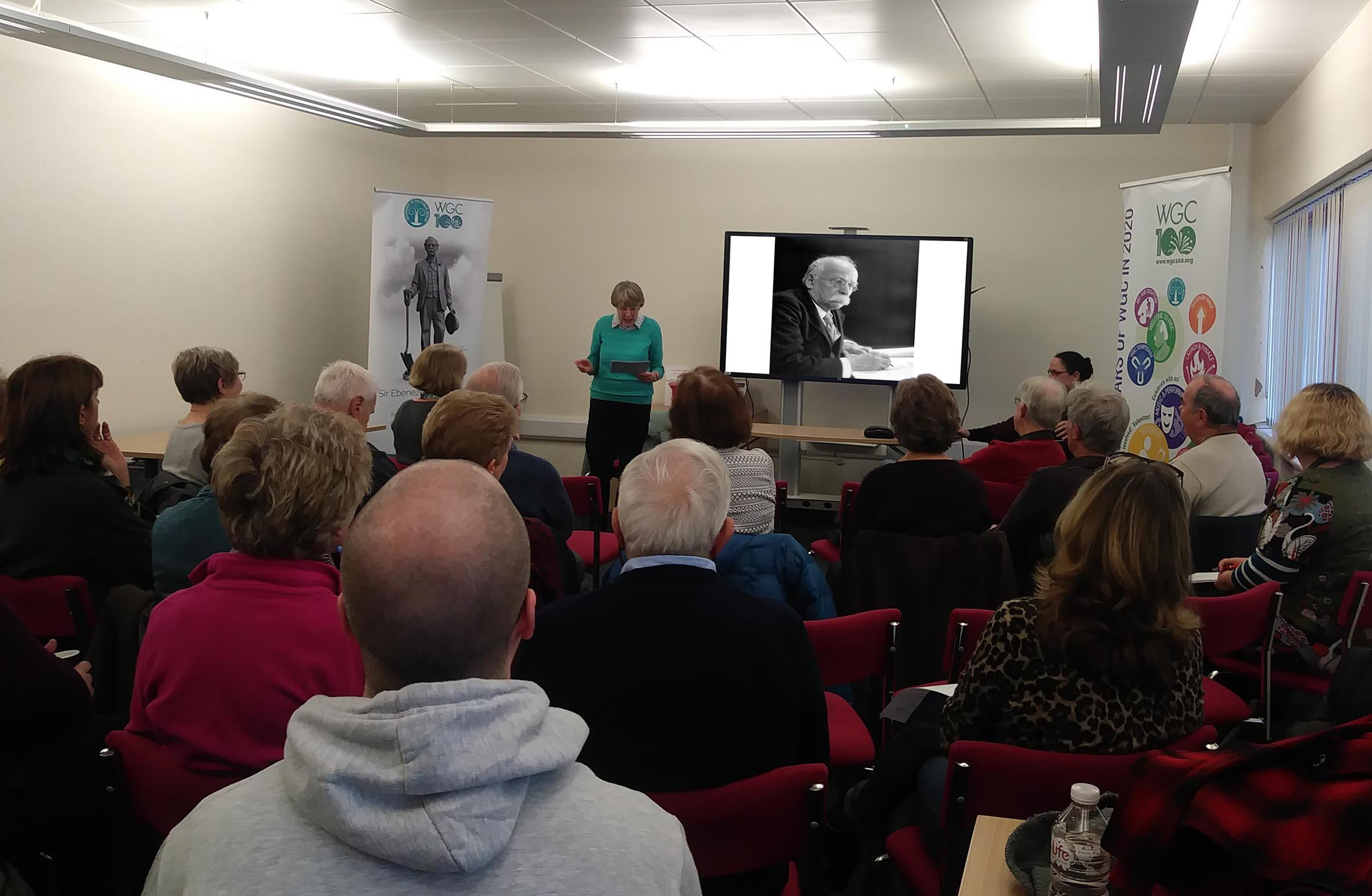 Angela Eserin speaking to WGC Centenary Foundation volunteers in WGC Library