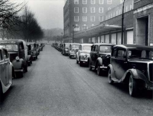 Cars parked both sides of road - Parkway, November 1954
