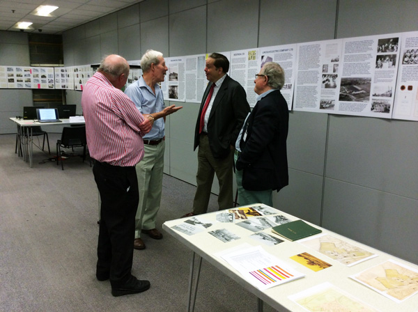 Lord Salisbury in discussion with three Trustees